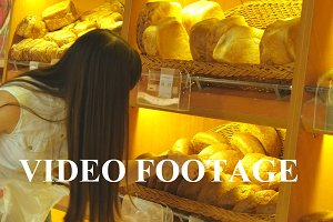 Young girl taking a loaf of bread