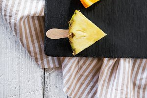 Fruit slice in dish black slate