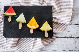 Fruit slice in dish black slate