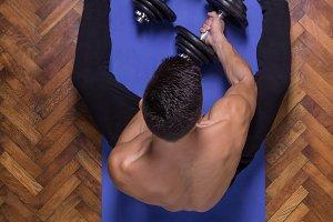 man grabbing taking weights dumbbell