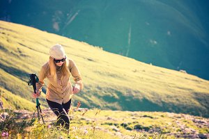 Young Woman hiking with trekking