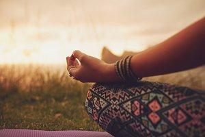 Female meditating outdoors