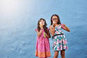 Cute little girls blowing soap