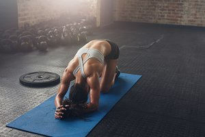 Fit young woman doing pilates