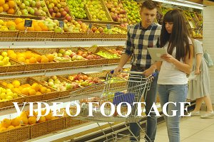 Couple walking in a supermarket