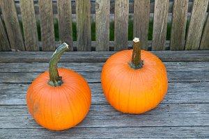 two pretty orange pumpkins