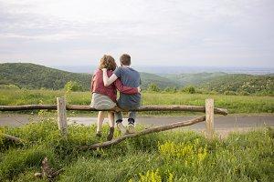 Rear couple hug landscape mountains