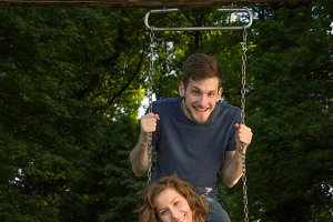 couple man woman swing fun