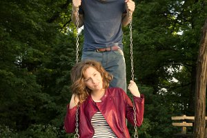 Couple on a swing, funny face