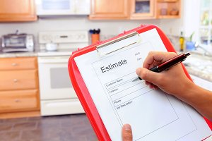 Contractor Writing on Estimate Form