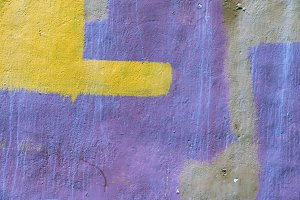 old wall painted yellow and purple
