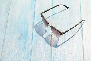 stylish sunglasses on table