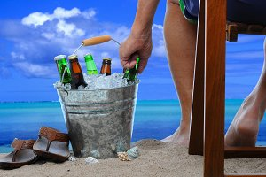 Man at the Beach and Bucket of Beer