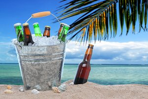 Beer Bottles in a Bucket at Beach