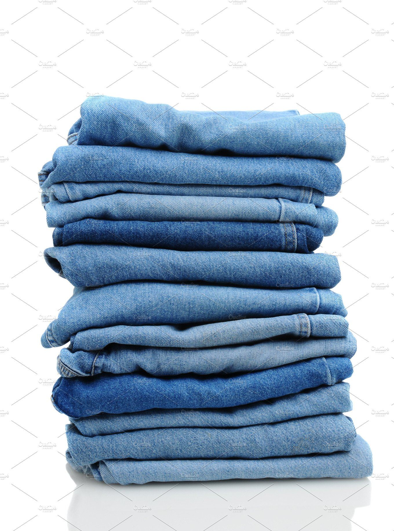 stack of blue jeans on white beauty amp fashion photos