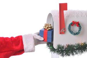 Santa Claus Putting Gift in Mailbox