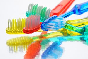 Toothbrushes on Reflective Surface