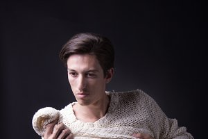 young man posing sweater studio shot