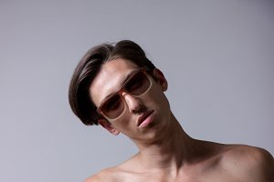 young man shirtless sunglasses