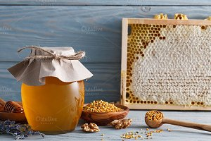 Honey jar, bee pollen and honeycombs