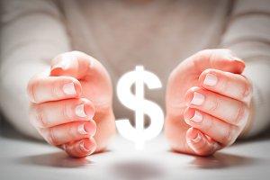 Dollar sign between woman's hands.