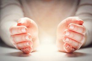Light between woman's hands.