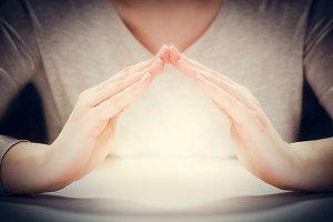 Light under woman's hands.