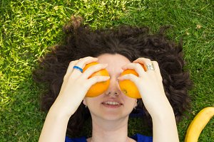 girl silly orange covering face