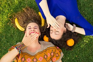 two young women laughing hands
