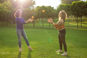 Two Young adult women fun playing