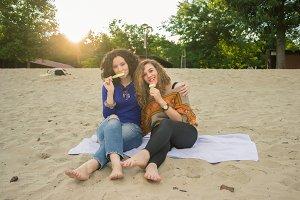 women hugging eating ice cream