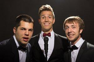 three man portrait suits bow ties
