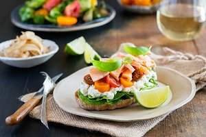 Sandwich with soft cheese, salmon and tomatoes