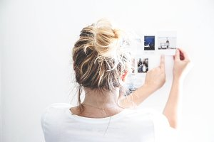 Blond hair girl with instax photos