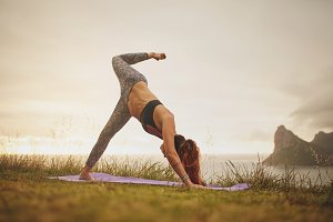 Woman on cliff in yoga position