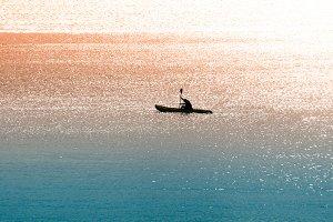 Sea canoeist at dawn