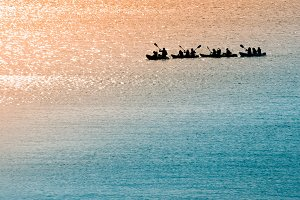 Sea canoeists at dawn