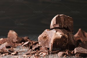 Chocolate pieces on dark background