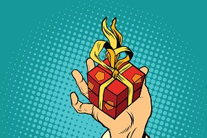 Hand of Santa Claus with gift