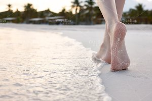 Walking on a beach, feet close up