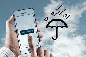Hand Using Mobile to Check Weather