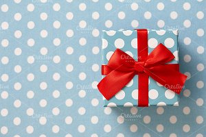 Gift box on blue dotted background