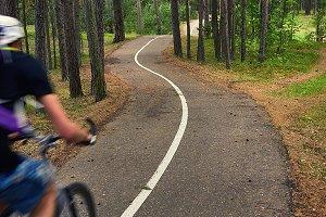 A cyclist rides along the bike path