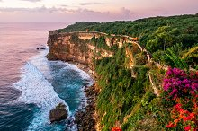 Scenic landscape of high cliff with fantastic sunset sky at Uluwatu cliff. Travel Bali, Indonesia