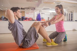young woman fitness instructor man