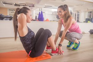 two women fitness instructor abs gym