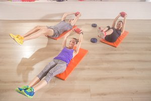 three people fitness exercise mat