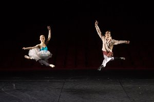Two ballet dancers jumping in air