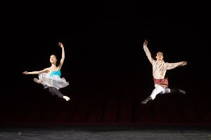 Two ballet dancers jumping