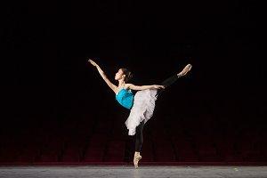 One ballerina stage standing one leg